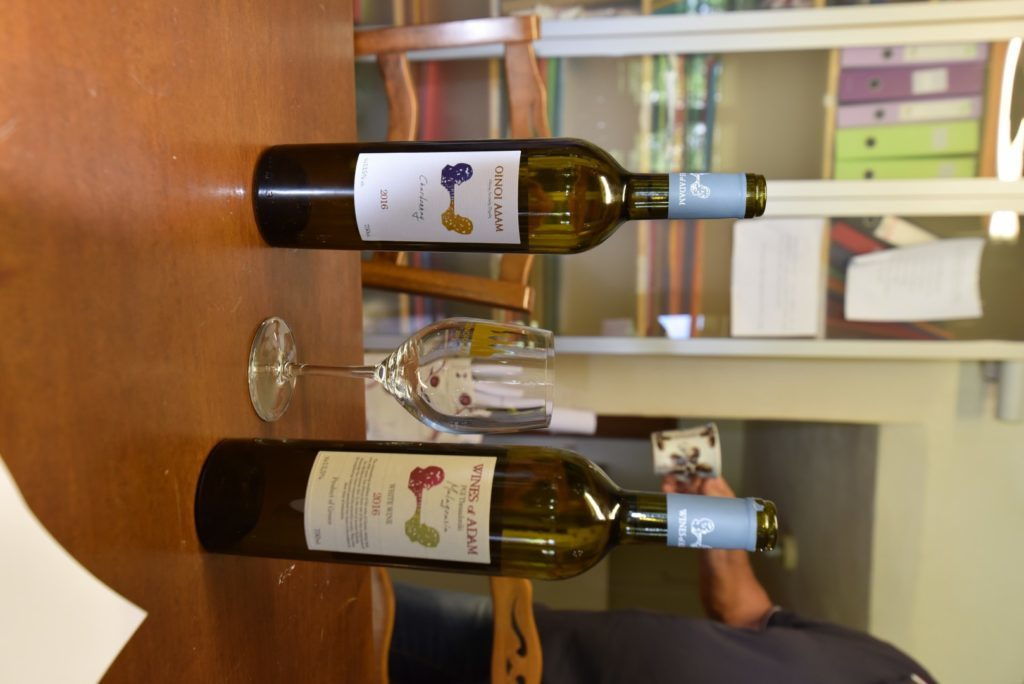 Bottles of Chardonnay and Malagouzia on a table